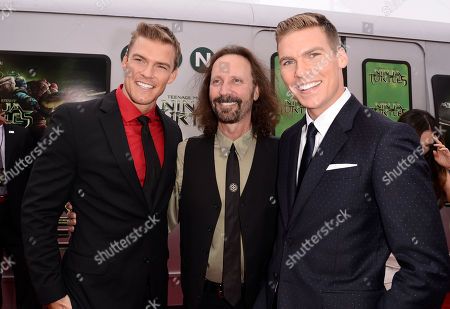 """Alan Ritchson, and from left, producer Scott Mednick and Pete Ploszek arrive at the Los Angeles premiere of """"Teenage Mutant Ninja Turtles"""" at the Regency Village Theater on"""