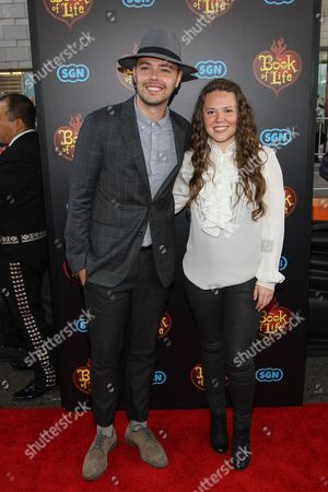 "Stock Picture of Jesse Eduardo Huerta Uecke and Tirzah Joy Huerta Uecke of Jessey and Joy attend the premiere of ""The Book of Life"" at Regal Cinemas at LA Live on Sun, in Los Angeles"