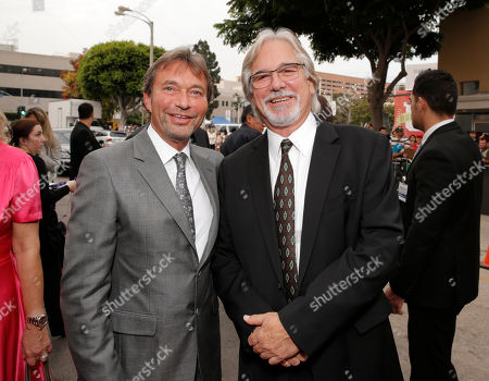 """Lionsgate Motion Picture Group co-chairman Patrick Wachsberger and Director Dean Parisot arrive on the red carpet at the LA premiere of """"Red 2"""" at the Westwood Village on in Los Angeles"""