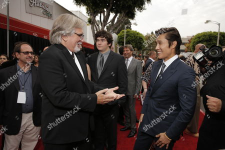"""Director Dean Parisot and Byung-hun Lee arrive on the red carpet at the LA premiere of """"Red 2"""" at the Westwood Village on in Los Angeles"""