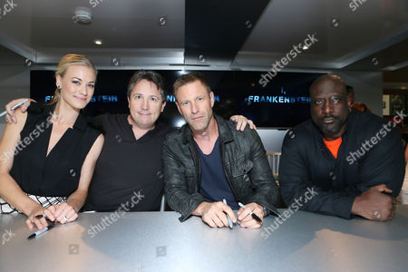 Yvonne Strahovski, Director Stuart Beattie Aaron Eckhart and writer/Executive Producer Kevin Grevioux seen at Lionsgate's 'I, Frankenstein' Talent Signing at 2013 Comic-Con, on Friday, July, 19, 2013 in San Diego, Calif