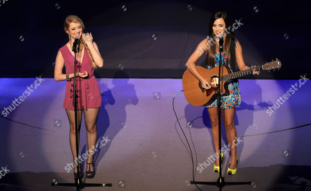 Liz Mace, left, and Megan Mace perform during the Nicole Richie for Impulse fashion show during Macy's Passport presents Glamorama 2012 at The Orpheum Theatre, in Los Angeles
