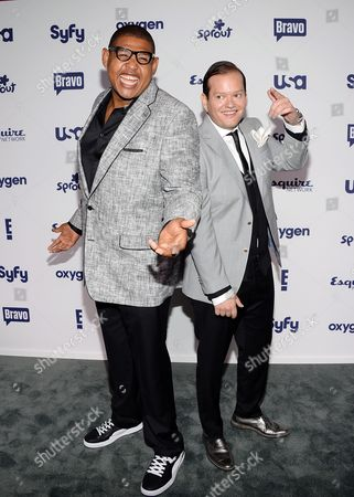"Omar Miller, left, and Andres Izquieta from ""Weekend Fix"" attend the NBCUniversal Cable Entertainment 2014 Upfront at the Javits Center, in New York"