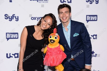 "Kaitlin Becker, left, Chica and Tim Kubart from the ""The Sunny Side Up Show"" attend the NBCUniversal Cable Entertainment 2014 Upfront at the Javits Center, in New York"