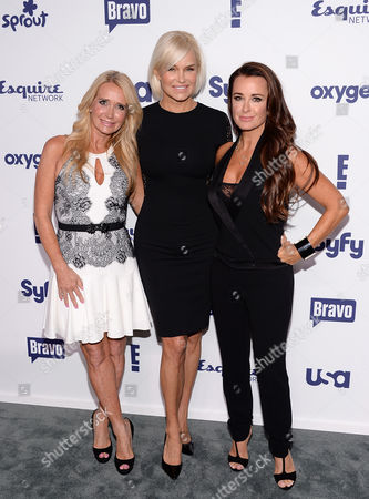 Kim Richards, left, Yolanda Foster and Kyle Richards attend the NBCUniversal Cable Entertainment 2014 Upfront at the Javits Center, in New York