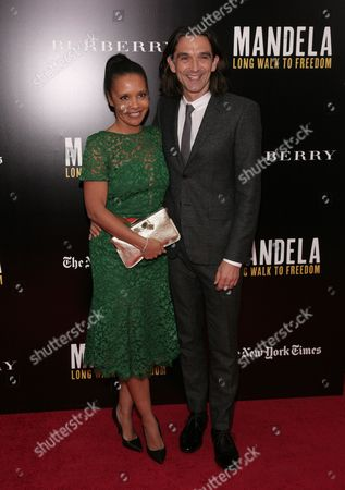 """Stock Image of Director Justin Chadwick, left, and his wife Michelle Chadwick, right, attend a screening of """"Mandela: Long Walk To Freedom"""" hosted by U2 and Anna Wintour on Monday, Nov., 25, 2013 in New York"""