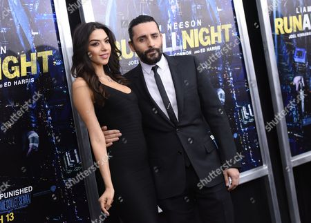 """Director Jaume Collet-Serra, right, and Isabel Burr attend the world premiere of """"Run All Night"""" at AMC Loews Lincoln Square, in New York"""