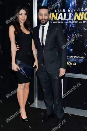 """Stock Image of Director Jaume Collet-Serra, right, and Isabel Burr attend the world premiere of """"Run All Night"""" at AMC Loews Lincoln Square, in New York"""