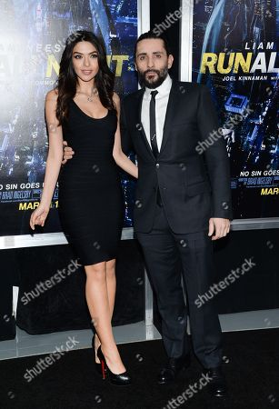 """Stock Picture of Director Jaume Collet-Serra, right, and Isabel Burr attend the world premiere of """"Run All Night"""" at AMC Loews Lincoln Square, in New York"""