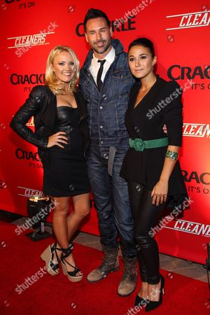 """From left, Emily Osment, writer/director Paul Leyden and Emmanuelle Chriqui arrive at the original series """"Cleaners"""" special screening at Sony Pictures Studios on in Culver City, Calif"""