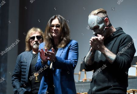 "Geezer Butler, from left, and Ozzy Osbourne of Black Sabbath pose with Corey Taylor of Slipknot during the ""Ozzfest Meets Knotfest"" news conference at the Hollywood Palladium, in Los Angeles. The ""Ozzfest Meets Knotfest"" multi-stage camping festival on Sept. 24-25 at the San Manuel Amphitheater and Festival Grounds in San Bernardino, Calif. was announced at the news conference"