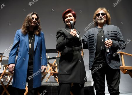 """Ozzy Osbourne, from left, Sharon Osbourne and Geezer Butler of Black Sabbath speak onstage during the """"Ozzfest Meets Knotfest"""" news conference at the Hollywood Palladium, in Los Angeles. The """"Ozzfest Meets Knotfest"""" multi-stage camping festival on Sept. 24-25 at the San Manuel Amphitheater and Festival Grounds in San Bernardino, Calif. was announced at the news conference"""
