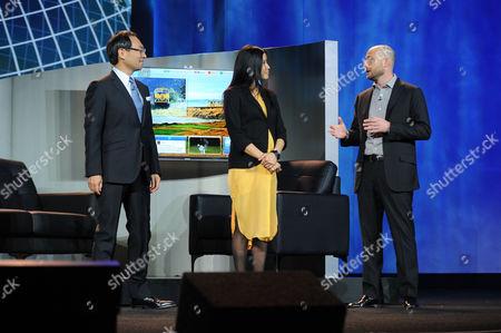 "Stock Photo of Left to right) CEO of Panasonic, Kazuhiro Tsuga, Lisa Ling, and Tim Vanderhook of Specific Media demonstrating ""My Home"" system at the International Consumer Electronics Show 2013,, Las Vegas, NV during the Panasonic Keynote presentation"