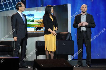 "Stock Image of Left to right) CEO of Panasonic, Kazuhiro Tsuga, Lisa Ling, and Tim Vanderhook of Specific Media demonstrating ""My Home"" system at the International Consumer Electronics Show 2013,, Las Vegas, NV during the Panasonic Keynote presentation"