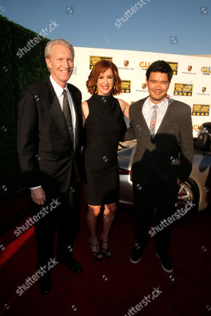 Stock Picture of From left, Chris McGurk, Chairman and CEO of Cinedigm, Jamie McGurk and Destin Cretton arrive at the 19th annual Critics' Choice Movie Awards presented by Porsche at The Barker Hangar in Santa Monica on