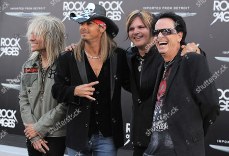 """From left, C.C. DeVille, Bret Michaels, Rikki Rockett and Bobby Dall, of musical group Poison, arrive at the """"Rock of Ages"""" premiere at Grauman's Chinese Theatre on in Los Angeles"""