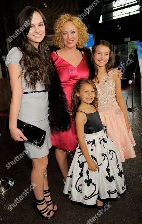 """Virginia Madsen, top, a cast member in the """"The Magic of Belle Isle,"""" poses with fellow cast members, from left, Madeline Carroll, Nicolette Pierini and Emma Fuhrmann at the premiere for the film at the Director's Guild of America on in Los Angeles"""
