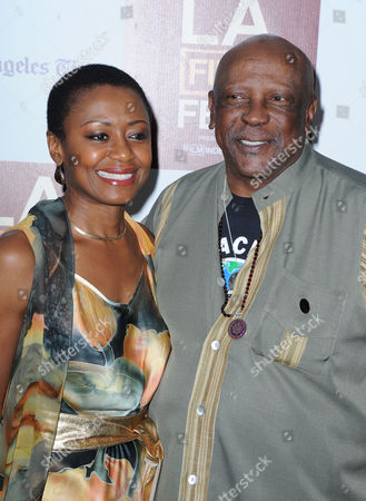 """Stock Image of Louis Gossett Jr., at left, and Barbara Eve Harris arrives at the L.A. gala screening for """"Middle of Nowhere"""" at Regal Cinemas L.A. Live on in Los Angeles"""