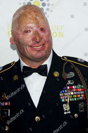 Stock Image of Staff Sgt. Robert Henline U.S. Army and arrives at the 6th Annual Stand Up For Heroes benefit concert for injured service members and veterans on in New York