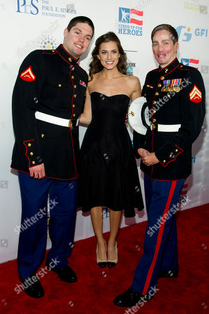 Michael Martinez, left, Allison Williams and Aaron Mankin arrive at the 6th Annual Stand Up For Heroes benefit concert for injured service members and veterans on in New York