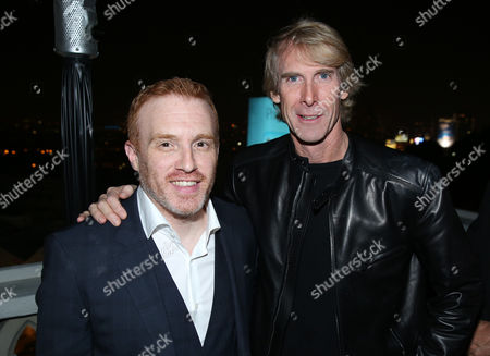 """Co-creator Jonathan E. Steinberg, left, and executive producer Michael Bay are seen at the Starz """"Black Sails"""" Premiere on in Los Angeles"""