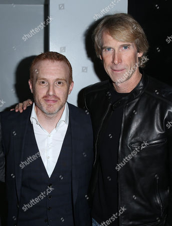 """Jonathan E. Steinberg, left, and executive producer Michael Bay arrive at the Starz """"Black Sails"""" Premiere on in Los Angeles"""