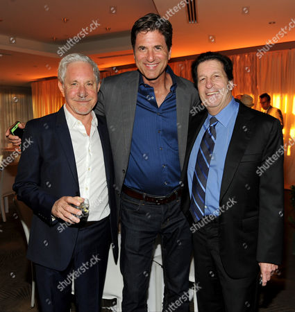 From left, Jeffrey Richman, Steve Levitan and Peter Roth attend the Television Academy's 66th Emmy Awards Performance Nominee Reception at the Pacific Design Center, in West Hollywood, Calif