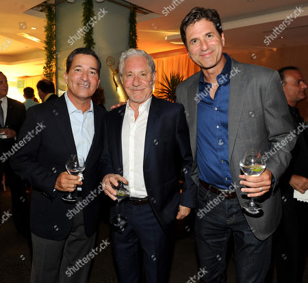 Academy Chairman & CEO Bruce Rosenblum, left, Jeffrey Richman and Steve Levitan, right, attend the Television Academy's 66th Emmy Awards Performance Nominee Reception at the Pacific Design Center, in West Hollywood, Calif