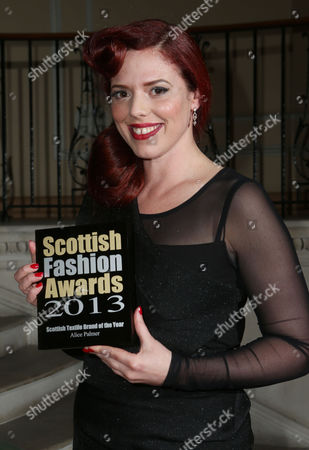 Stock Picture of Alice Palmer holds the Textile Brand of the Year award at the 8th Annual Scottish Fashion Awards 2013 dinner, celebrating Scotland's fashion talent, at Dover House, in central London, as part of a Scottish fashion invasion of London