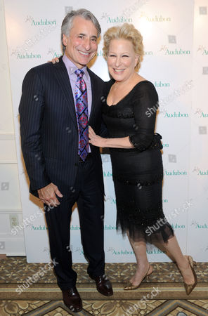 Bette Midler poses with David Yarnold, President & CEO, The National Audubon Society, at the organization's first gala to jointly award the Audubon Medal and the inaugural Dan W. Lufkin Prize for Environmental Leadership, in New York
