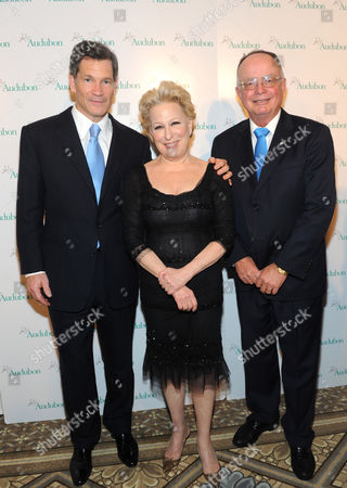 Bette Midler poses with honorees Louis Bacon, left, and George Archibald at The National Audubon Society's first gala to jointly award the Audubon Medal and the inaugural Dan W. Lufkin Prize for Environmental Leadership, in New York