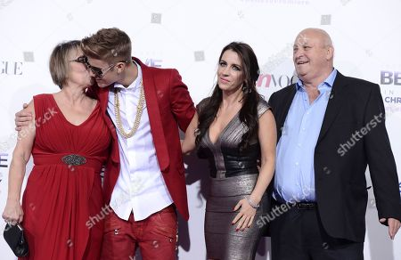 "Singer Justin Bieber, second from left, poses with Grandmother Diane Dale, left, his Mother Pattie Mallette, second from right, and his Grandfather Bruce Dale at the premiere of the feature film ""Justin Bieber's Believe"" at Regal Cinemas L.A. Live on in Los Angeles"