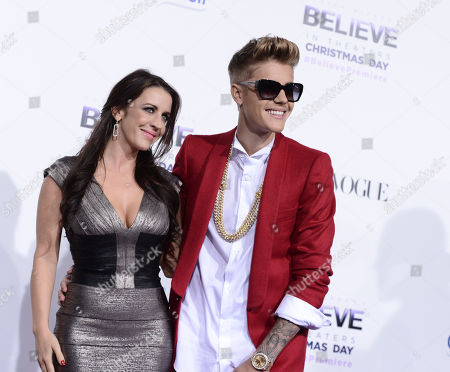 "Singer Justin Bieber, right, and his Mother Pattie Mallette, arrive at the premiere of the feature film ""Justin Bieber's Believe"" at Regal Cinemas L.A. Live on in Los Angeles"
