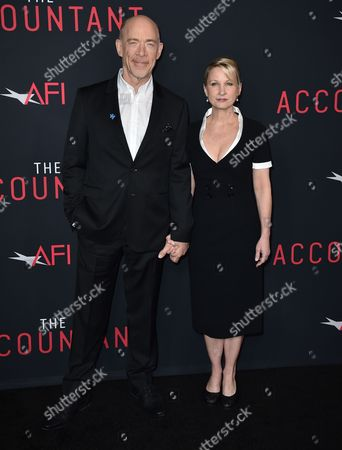 """J.K. Simmons, left, and Michelle Schumacher arrive at the world premiere of """"The Accountant"""" at the TCL Chinese Theatre, in Los Angeles"""