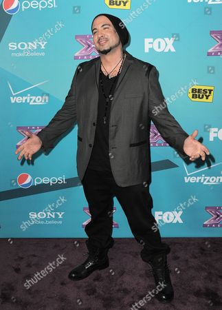"""Stock Picture of Vino Alan, 40, of Laquey, MO, arrives at the """"X-Factor"""" Finalists Party, in Los Angeles"""
