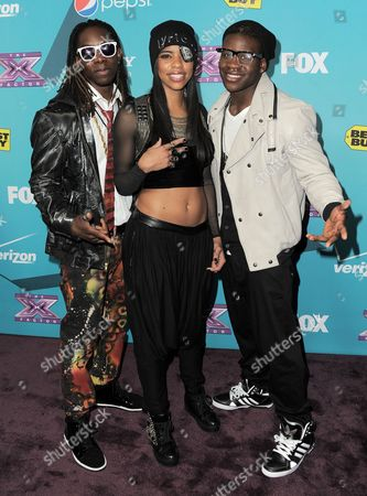 """Stock Photo of Jemelie Joseph, Lyric Da Queen and Lyric Da Queen of the group Lyric 145 arrive at the """"X-Factor"""" Finalists Party, in Los Angeles"""