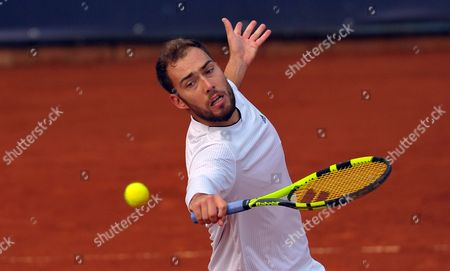 Jerzy Janowicz of Poland returns the ball to Florian Mayer of Germany during quarterfinal match at the Challenger ATP Pekao Open tennis tournament in Szczecin, Poland, 15 September 2017.
