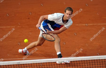 Stock Photo of Florian Mayer of Germany returns the ball to Jerzy Janowicz of Poland during quarterfinal match at the Challenger ATP Pekao Open tennis tournament in Szczecin, Poland, 15 September 2017.