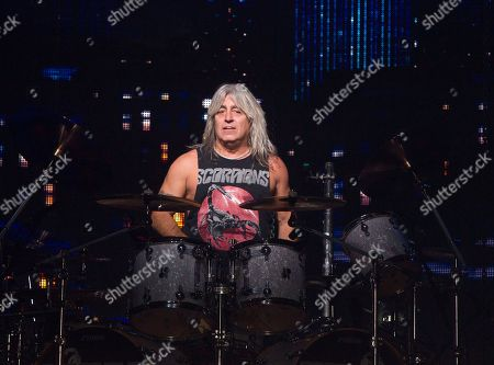 """Stock Image of Mikkey Dee of the band Scorpions performs in concert during their """"Crazy World Tour"""" at the Santander Arena, in Reading, Pa"""