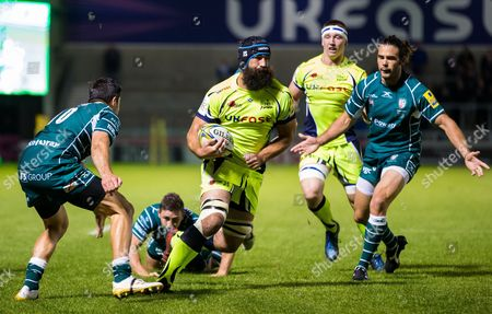 Josh Strauss of Sale Sharks takes on James Marshall of London Irish