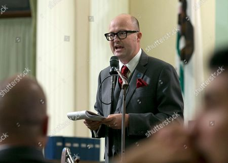 """Assemblyman Matthew Harper, R-Huntington Beach, urges lawmakers to reject a """"sanctuary state"""" bill before the Assembly, in Sacramento, Calif. The Assembly approved the bill, SB54, by Senate President Pro Tem Kevin de Leon, D-Los Angeles, that would limit police cooperation with federal immigration authorities. It now goes to the Senate for final approval"""