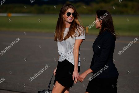 Hope Hicks, Dina Powell. White House communications director Hope Hicks, left, walks with White House deputy national security adviser Dina Powell after landing at Morristown Municipal airport with President Donald Trump, in Morristown, N.J