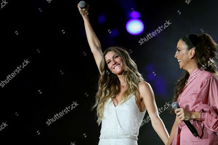 Brazilian model Gisele Bundchen (L) gives a message during the opening of singer Ivete Sangalo (R) concert in the first day of the music festival Rock in Rio, at the Palco Mundo, in Rio de Janeiro, Brazil, 15 September 2017.