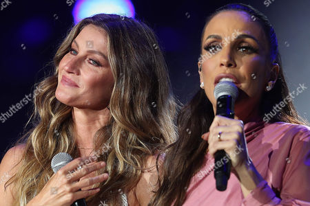 Brazilian model Gisele Bundchen (L) gives a message during the opening of singer Ivete Sangalo (R) concert on the first day of the music festival Rock in Rio, at the Palco Mundo, in Rio de Janeiro, Brazil, 15 September 2017.