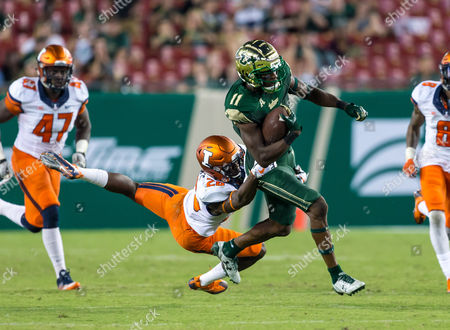 Illinois Fighting Illini defensive back Evan Jones (26) tackles South Florida Bulls wide receiver Marquez Valdes-Scantling (11) in the 2nd half during the game between the Illinois Fighting Illini and the South Florida Bulls at Raymond James Stadium in Tampa, Florida