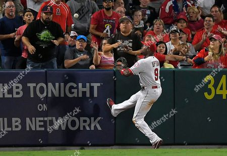 Los Angeles Angels left fielder Justin Upton watches a ball hit by Texas Rangers' Shin-Soo Choo, of South Korea, go out for a two-run home run during the sixth inning of a baseball game, in Anaheim, Calif