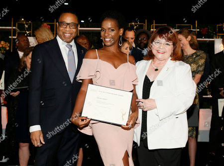 Kelsey Scott, Hayma Washington, Patrika Darbo. Emmy nominee Kelsey Scott, center, poses with Hayma Washington, Chairman and CEO of the Television Academy, left, and Patrika Darbo is seen at the 2017 Performers Nominee Reception Presented by the Television Academy at the Wallis Annenberg Center for the Performing Arts, in Beverly Hills, Calif