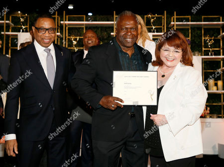 Hayma Washington, Kim Estes, Patrika Darbo. Emmy nominee Kim Estes, center, poses with Hayma Washington, Chairman and CEO of the Television Academy, left, and Patrika Darbo at the 2017 Performers Nominee Reception Presented by the Television Academy at the Wallis Annenberg Center for the Performing Arts, in Beverly Hills, Calif