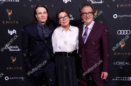 Stock Image of Geoffrey Rush, Jane Menelaus, James Rush. Actor Geoffrey Rush, right, poses with his wife Jane Menelaus and their son James at the 69th Primetime Emmy Awards Performers Nominee Reception at the Wallis Annenberg Center for the Performing Arts, in Beverly Hills, Calif