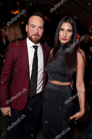 Dana Brunetti and guest seen at Netflix annual Emmy Nominee toast at the home of Ted Sarandos and Nicole Avant in Los Angeles, CA on September 15, 2017